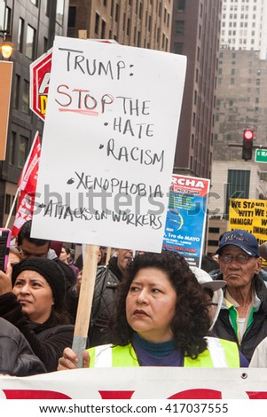 CHICAGO, ILLINOIS - MAY 1, 2016: Hundreds of marchers united on May Day around a protest of Donald Trump and his hateful rhetoric and the right-wing agenda against immigrants and worker rights.