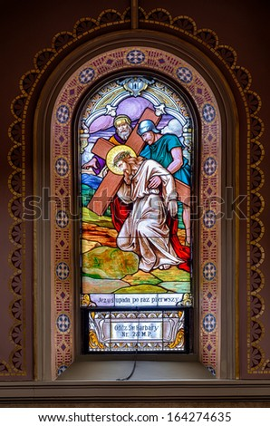 "CHICAGO, ILLINOIS - NOVEMBER 22: Stained glass window titled ""Jesus Falls the First Time"" in the Saint Mary of the Angels Church on November 22, 2013 in Chicago, Illinois - stock photo"