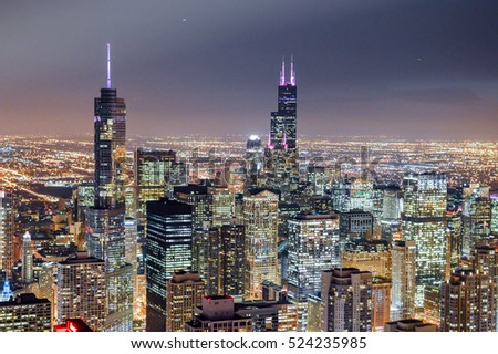 CHICAGO, ILLINOIS - OCTOBER 30, 2014 -  Aerial view of Chicago downtown at twilight from high above.