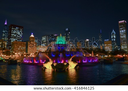 CHICAGO, ILLINOIS - OCTOBER 14, 2012 - Buckingham Fountain is a Chicago landmark in the center of Grant Park view at night with skyscrapers in the background - stock photo