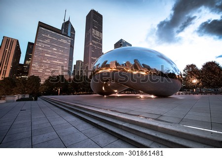 CHICAGO, ILLINOIS - OCTOBER 9: Cloud Gate (The Bean) on October 6, 2012 in Chicago, Illinois. Cloud Gate, a sculpture by artist Anish Kapoor, is the centerpiece of the AT&T Plaza. - stock photo