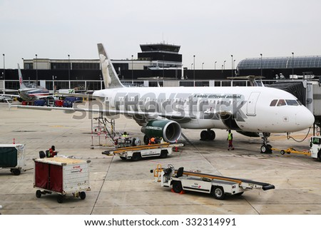 CHICAGO, ILLINOIS - OCTOBER 25, 2015: Frontier Airlines Airbus A320 plane at the gate at O'Hare International Airport in Chicago - stock photo