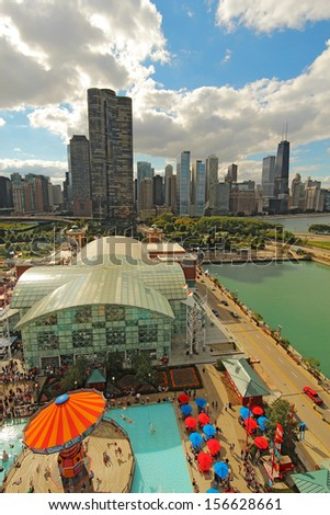 CHICAGO, ILLINOIS - SEPTEMBER 4: Aerial view of Navy Pier in Chicago, Illinois with a skyline background on September 4, 2011. The Pier is a popular destination with many attractions on Lake Michigan. - stock photo