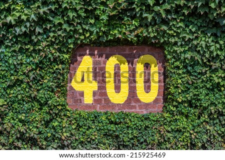 CHICAGO, ILLINOIS - SEPTEMBER 8: 400 feet sign on the outfield wall of Wrigley Field on September 8, 2014 in Chicago, Illinois - stock photo