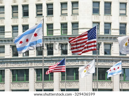 CHICAGO, ILLINOIS, UNITED STATES - JULY 29, 2008: American, Illinois and Chicago flags outside the Wrigley building on July 29, 2008 in Chicago, United States. - stock photo