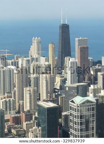 CHICAGO, ILLINOIS, UNITED STATES - JULY 31, 2008 - Urban landscape architectural aerial view over city of Chicago and Lake Michigan on a sunny summer day on July 31, 2008.