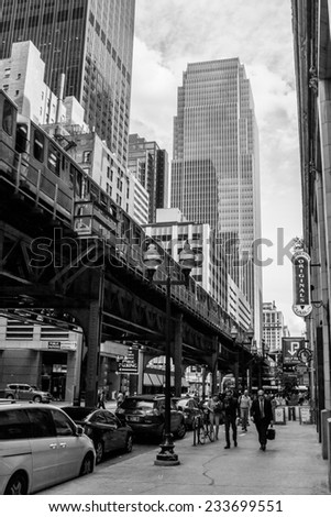 CHICAGO, ILLINOIS/UNITED STATES - JUNE 17, 2014:  Chicago L-train and architecture in the Loop district, photographed on June 17, 2014 in Chicago, Illinois.
