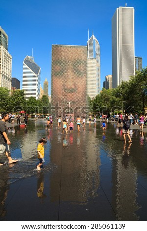 Chicago, Illinois USA - August 21, 2011: Visitors enjoying the popular Crown Fountain in Millennium Park on a hot summer day in Chicago. - stock photo