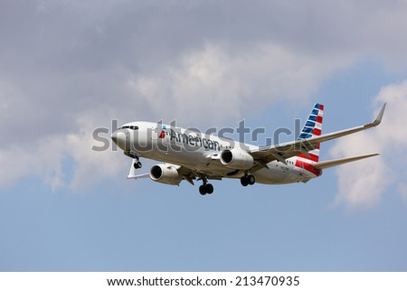 CHICAGO, ILLINOIS / USA - July 20th, 2013: View of an American Airlines Boeing 737-800 passenger jet in new American paint scheme on approach to landing at Chicago O'Hare International Airport (ORD).  - stock photo