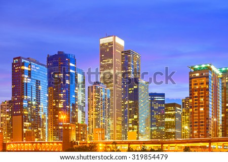 Chicago Illinois, USA Skyline of downtown modern illuminated buildings skyline at sunset  - stock photo