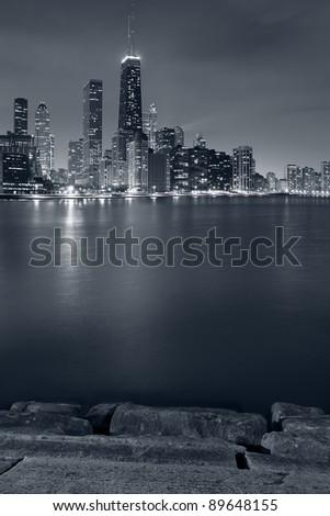 Chicago. Image of Chicago skyline and Lake Michigan coastline at night. - stock photo