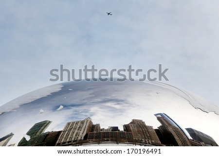 CHICAGO - January 7: The Cloud Gate also known as the Bean covered in snow with a view of the skyline. A famous art piece in AT&T Plaza at Millennium Park, January 7, 2014 in Chicago, Illinois. - stock photo