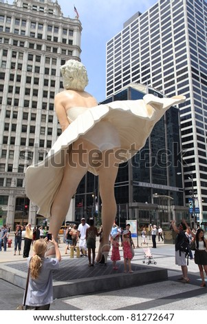CHICAGO - JULY:  A giant 26 foot tall sculpture of Marilyn Monroe was unveiled in Chicago on July 18, 2011.  Created by artist Seward Johnson, the work stands in a square on Michigan Avenue. - stock photo