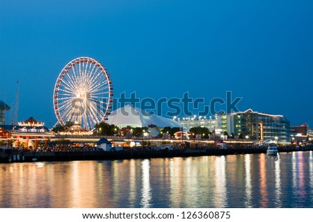 CHICAGO - JULY 4: Navy Pier, the Midwest's number one tourist destination, on July 4, 2012 in Chicago. Navy Pier attracts more than 8.6 million visitors a year. - stock photo