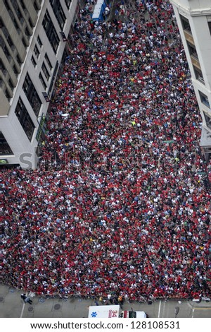 CHICAGO - JUNE 11: An estimated two million fans gather along Michigan Avenue to catch a glimpse of a parade celebrating the Chicago Blackhawks' Stanley Cup win on June 11, 2010 in Chicago, Illinois.