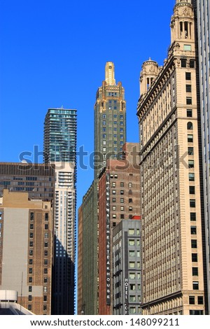 CHICAGO - JUNE 17: Classic skyscrapers near the Chicago River on June 17, 2012 in Chicago, The Windy City is the third largest city in the U.S. and is a worldwide center of commerce.  - stock photo