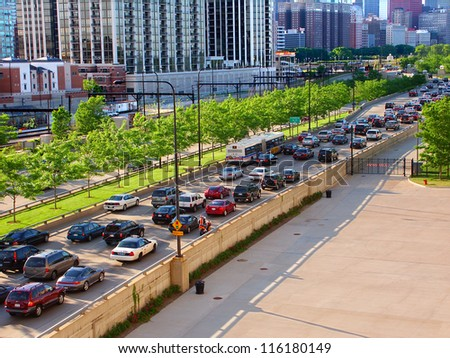 CHICAGO - JUNE 07: Lakeshore Drive rush hour traffic on June 07, 2005 in Chicago, Illinois.  Lakeshore Drive runs parallel to Lake Michigan and was originally constructed in 1937. - stock photo