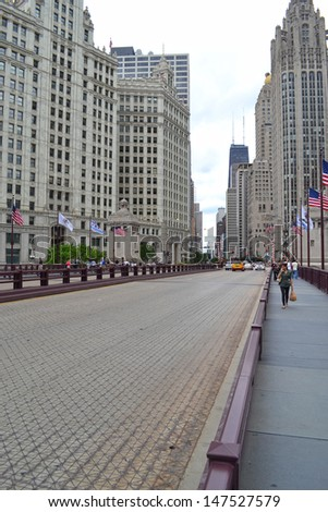"CHICAGO - JUNE 14: Michigan Avenue Bridge over the Chicago River on June 14, 2011 in Chicago, Illinois. Michigan Avenue is also known as the ""Magnificent Mile."" - stock photo"