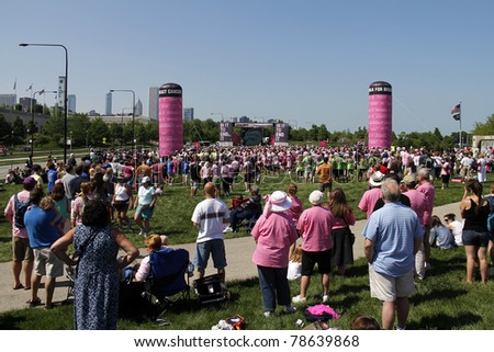CHICAGO - JUNE 5, 2011: Participants and supporters at the final ceremony festivities at the Avon Walk for Breast Cancer outside Soldier Field on June 5, 2011 in Chicago, IL. - stock photo