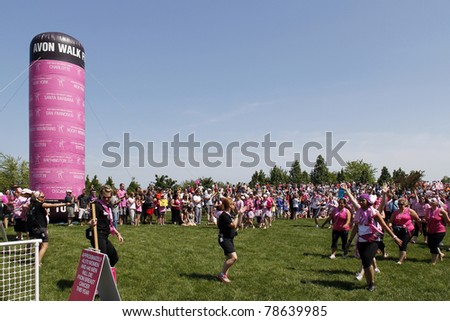 CHICAGO - JUNE 5: Participants just entering the final ceremony festivities at the Avon Walk for Breast Cancer at Soldier Field on June 5, 2011 in Chicago, IL.. - stock photo