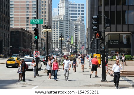 CHICAGO - JUNE 27: People walk downtown on June 27, 2013 in Chicago. Chicago is the 3rd most populous US city with 2.7 million residents (8.7 million in its urban area). - stock photo