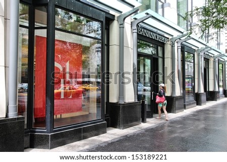 CHICAGO - JUNE 26: Shopper enters Banana Republic store at Magnificent Mile on June 26, 2013 in Chicago. The Magnificent Mile is one of most prestigious shopping districts in the United States. - stock photo