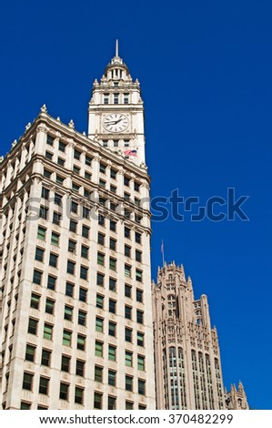 Chicago: looking up at Wrigley building from a canal cruise on Chicago River on September 22, 2014. Wrigley building was built to house the corporate headquarters of Wrigley Company - stock photo
