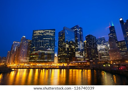 Chicago Loop skyline and Chicago River at evening, IL, USA - stock photo