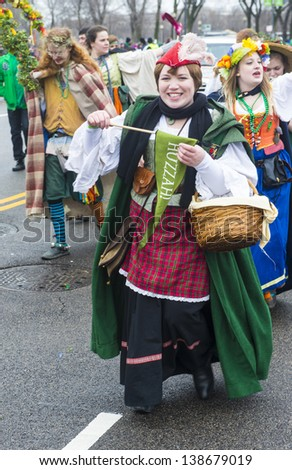 CHICAGO - MARCH 16 : People with a Renaissance costume Participating in the annual Saint Patrick's Day Parade in Chicago on March 16 2013