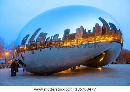 CHICAGO - MARCH 14 : View of the  Cloud Gate sculpture in Millennium Park in Chicago on March 14 2013 , The sculpture is nicknamed The Bean , designed by British artist Anish Kapoor. - stock photo