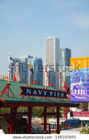 CHICAGO - MAY 19: Navy Pier on May 19, 2013 in Chicago, IL. It's is a 3,300-foot (1,010 m) long pier on the Chicago shoreline of Lake Michigan. Navy Pier is Chicago's number one tourist attraction.