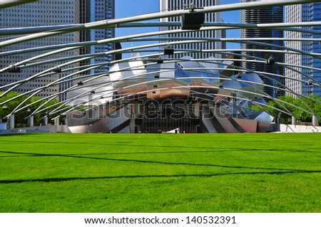 CHICAGO - MAY 18: The Jay Pritzker Pavilion in Chicago on May 18, 2012. The 11,000 capacity pavilion was constructed between June 1999 and July 2004. It serves as the centerpiece for Millennium Park. - stock photo