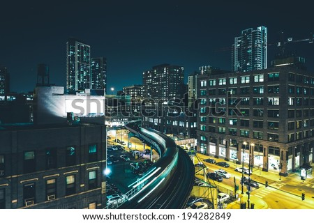 Chicago Night Train Rush and Downtown Chicago Streets - stock photo
