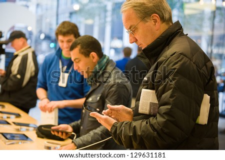 CHICAGO - NOVEMBER 2: The iPad Mini is released at Apple's North Michigan Avenue store on November 2, 2012 in Chicago. The iPad mini features a reduced screen size of 7.9 inches. - stock photo