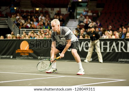 CHICAGO - OCTOBER 17: John McEnroe on October 17, 2012 competing in the 2012 Powershares QQQ Challenge at the United Center in Chicago. - stock photo
