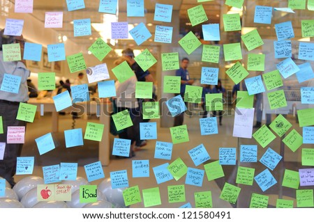 CHICAGO - OCTOBER 6: notes to Steve Jobs on the glass of Apple store, October 6, 2011 Chicago, IL, USA. Mr Jobs died on Oct 5, 2011. - stock photo