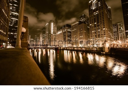 Chicago River in Gold. Downtown Chicago Illinois and Chicago River at Night. Browny Gold Color Grading. - stock photo
