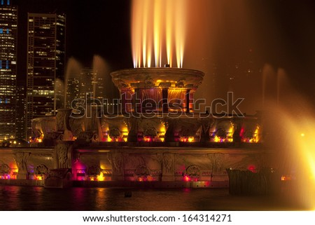 Chicago's Buckingham Fountain illuminated at night - stock photo