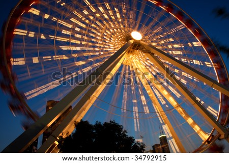 Chicago's Navy Pier amusement park at night with lighted Ferris Wheel - stock photo