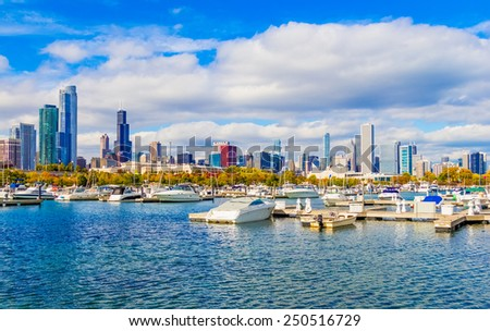 Chicago skyline and Lake Michigan after a clearing storm, Illinois. Boats are docked in harbor. - stock photo