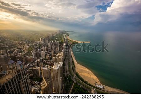 Chicago skyline and lake Michigan at sunset. - stock photo