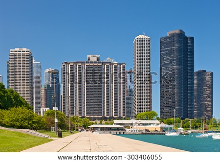 Chicago skyline and marina on a beautiufl summer day with blue sky - stock photo