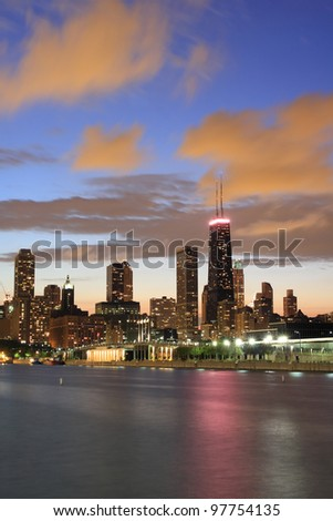 Chicago Skyline at dusk with the Hancock Building and cloudy sky
