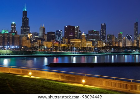 Chicago skyline. Image of Chicago skyline at night with reflection of the city lights in Lake Michigan.