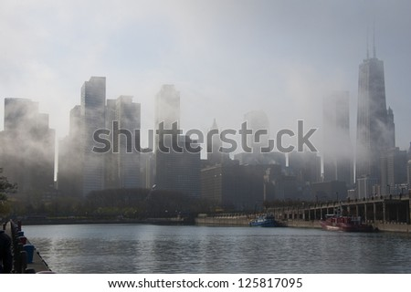 Chicago skyline in daytime fog, from Navy Pier - stock photo