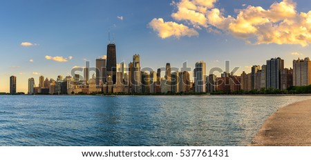 Chicago skyline panorama across Lake Michigan at sunset viewed from North Avenue Beach