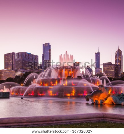 Chicago skyline panorama with skyscrapers and Buckingham fountain at twilight. - stock photo