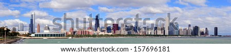 Chicago skyline panorama with skyscrapers over Lake Michigan with cloudy blue sky. - stock photo