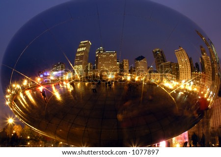 Chicago Skyline reflected in sculpture at night - stock photo