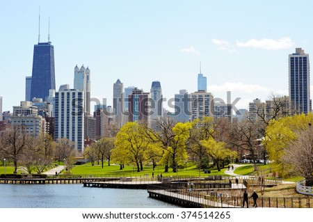 Chicago skyline with skyscrapers viewed from Lincoln Park over lake  - stock photo